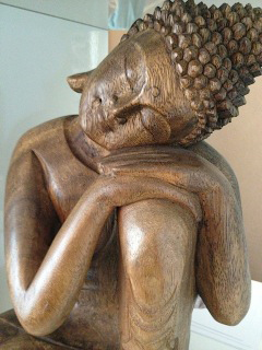 Buddha resting head on knee